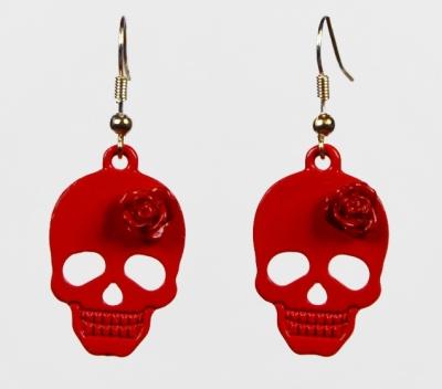 Les boucles d'oreilles tête de mort et rose